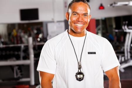 happy male personal trainer half length portrait photo