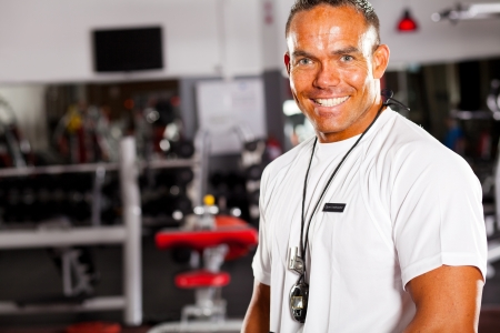 happy male gym instructor portrait photo