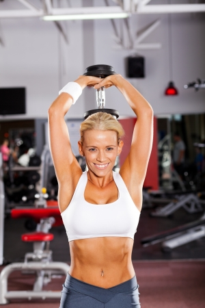 young fitness woman workout with dumbbell photo