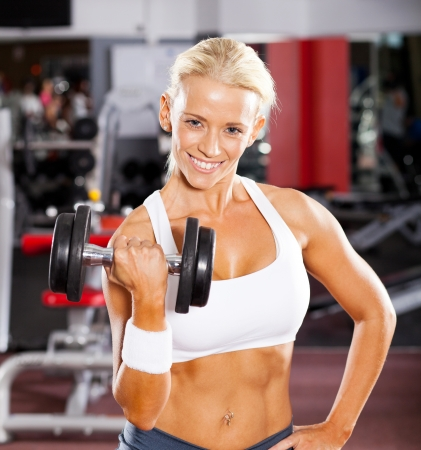 fitness woman working out with dumbbell in gym Stock Photo - 13737499