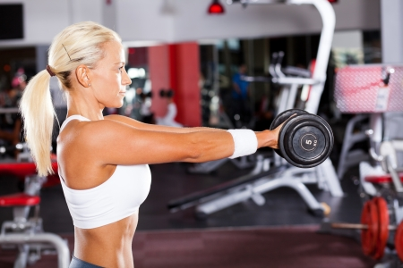 fit woman doing workout with dumbbell Stock Photo - 13738488