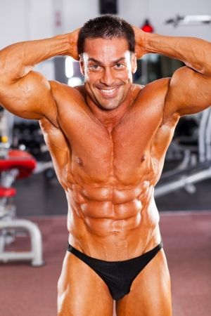 happy male bodybuilder in gym photo