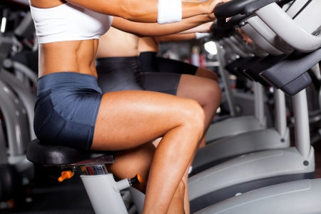 cardio fitness: group of women cycling in gym