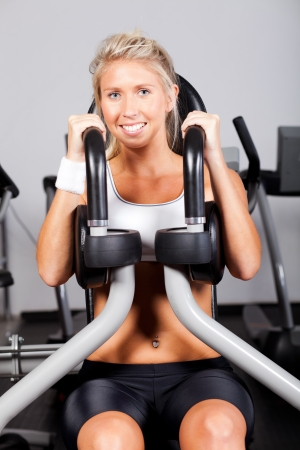 young woman working out with peck deck machine in gym Stock Photo - 13738432
