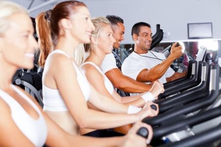sport coach training cyclists in gym  photo
