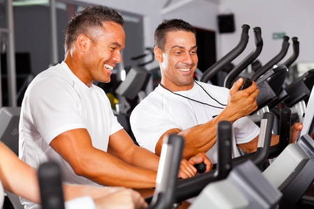 fitness man and personal trainer in gym photo