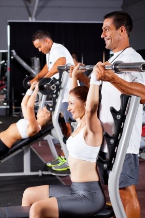 fitness women and personal trainers in gym photo