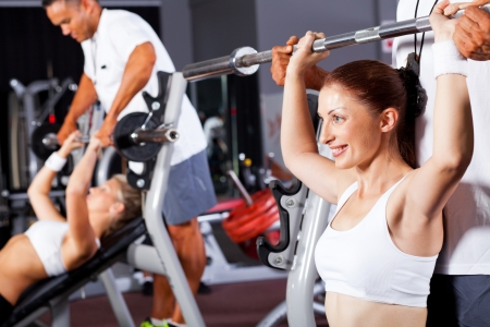 fitness woman with personal trainer in gym Stock Photo - 13738424