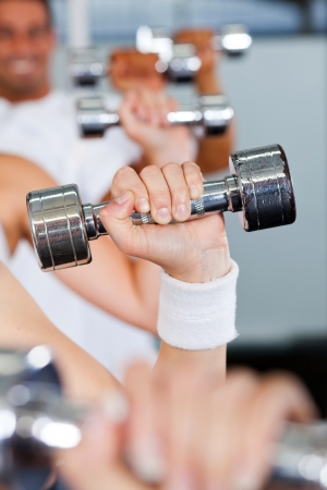 exercise with dumbbell in gym photo