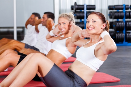 sit ups: fitness people doing sit ups in gym