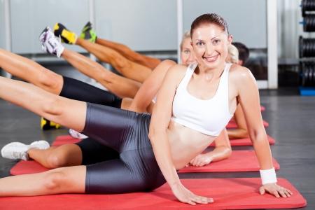 group of people doing gym aerobics photo