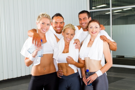 group of fitness people portrait in gym photo
