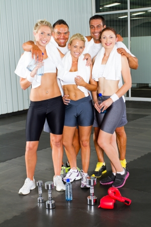 group of fitness people in gym photo