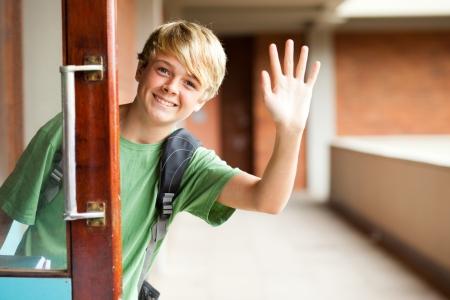 cute high school boy waving good bye Stock Photo - 13738013