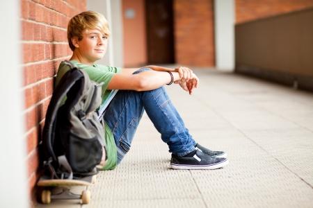 cute male high school student sitting on floor Stock Photo - 13738804