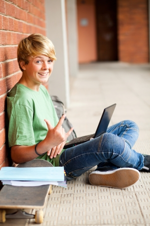 funny high school student giving funky hand sign Stock Photo - 13738755