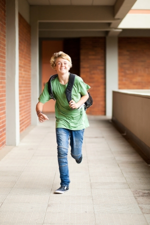 male middle school student running in school passage photo