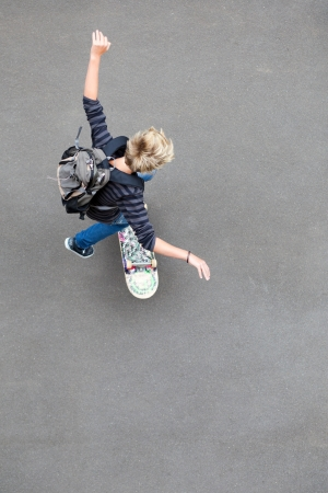 skateboarding tricks: overhead view of teen boy skateboarding Stock Photo