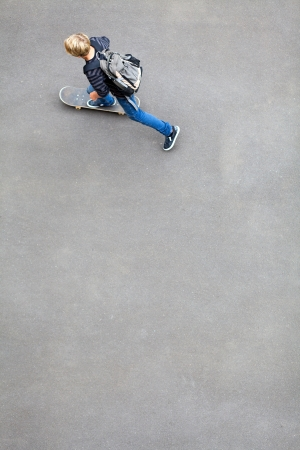 skateboarding tricks: above view of a teen boy skateboarding