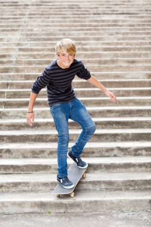 teen boy skateboarding on stairs photo