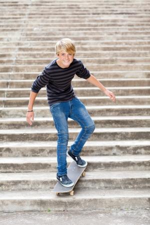 boy skater: teen boy skateboarding on stairs