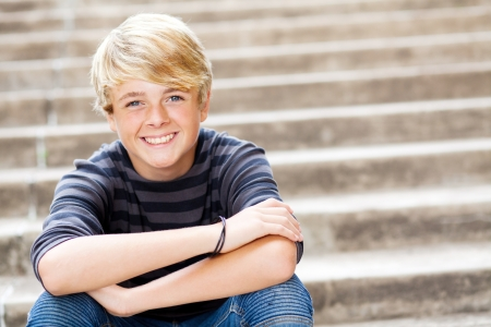 boy sitting: cute teen boy closeup portrait Stock Photo