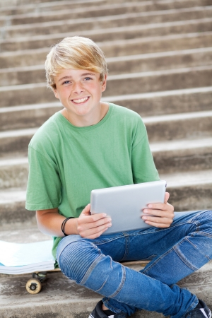 young teen boy using tablet computer Stock Photo - 13737903