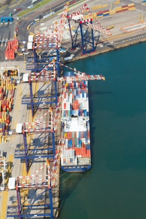 vessel offloading containers at durban harbour, south africa photo