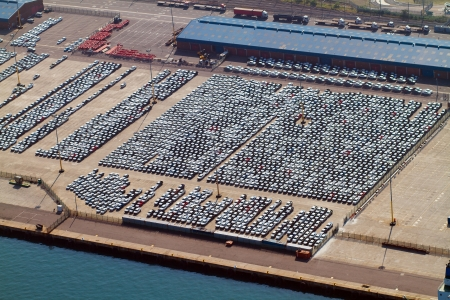 aerial view of large amount of automobiles parked at durban harbour, south africa photo
