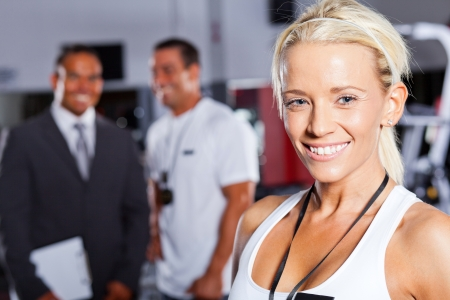 pretty female gym trainer closeup portrait photo