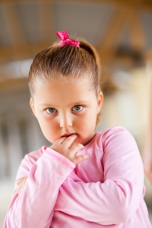 vigilant: cute little girl looks scared Stock Photo