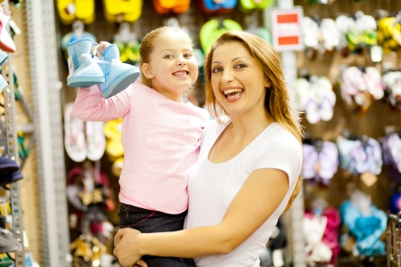 mother and daughter shopping for shoes photo