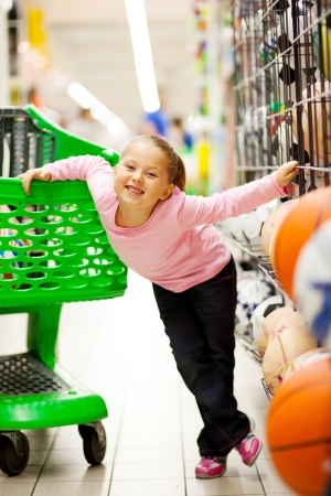 happy little girl supermarket photo