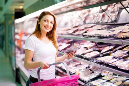 supermarket shopping: young woman shopping in supermarket