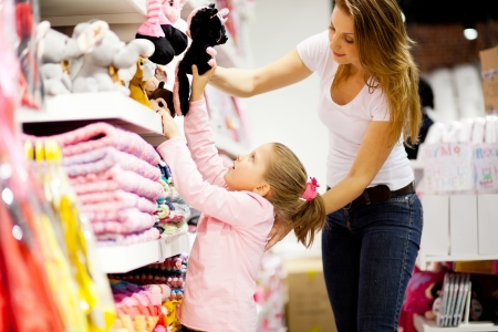 shopping center: mother and daughter shopping for toys Stock Photo