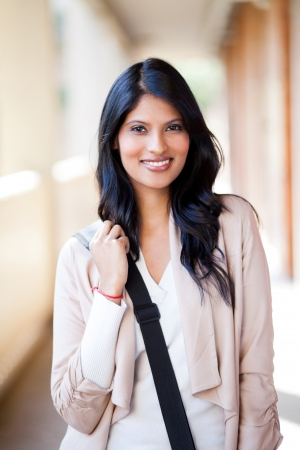 beautiful female college student with shoulder bag photo