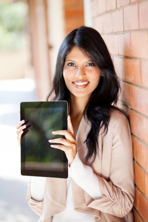 beautiful young female university student holding a tablet computer photo