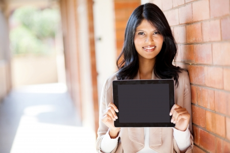 young attractive female college student presenting a tablet computer photo