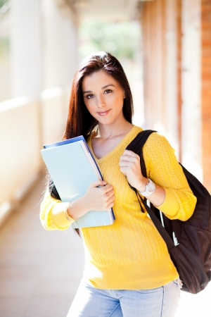 pretty female university student with books and backpack photo