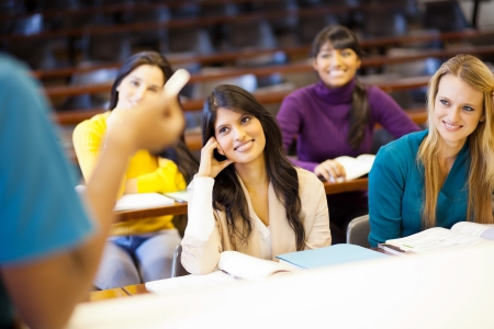 college professor lecturing group of students in classroom photo