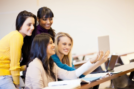 group of college students using tablet computer in classroom photo
