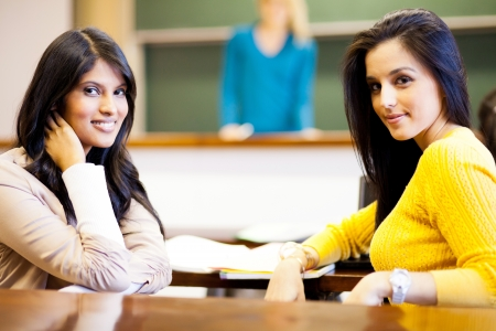 two female college students in classroom photo
