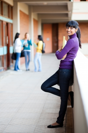 campus: pretty young female college student full length portrait