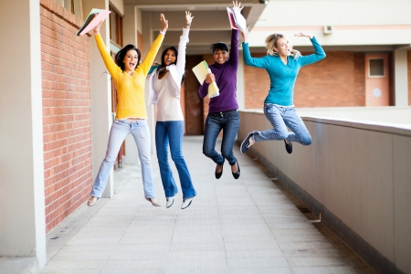 group of female college students jumping up photo