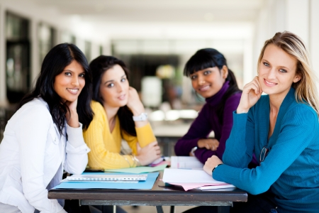 cafeterias: group of female college students sitting by school cafeteria