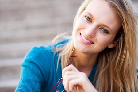sweater girl: young blond woman closeup portrait