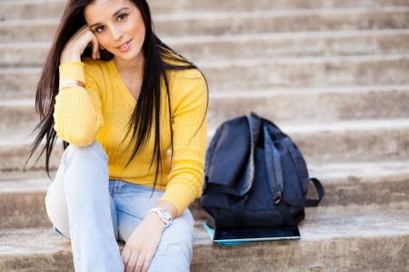 sexy school girl: attractive young female college student sitting outdoors Stock Photo