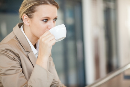 young businesswoman drinking coffee during break photo