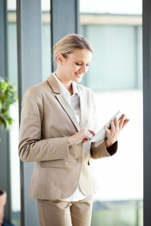 blue collar: beautiful young businesswoman using tablet computer in office