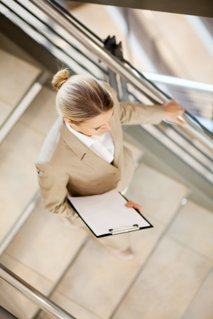 young businesswoman walking down stairs photo